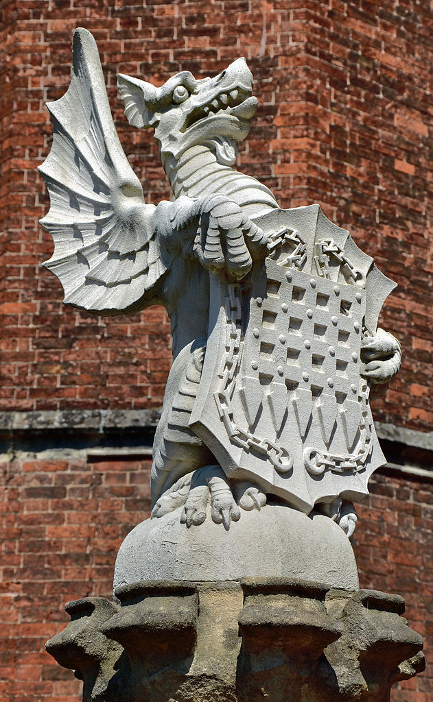 The Queen's Beasts - the red dragon of Wales bearing the portcullis emblem of the Palace of Westminster By Duncan Harris from Nottingham, UK (The Queen's Beasts) [CC-BY-2.0 (http://creativecommons.org/licenses/by/2.0)], via Wikimedia Commons