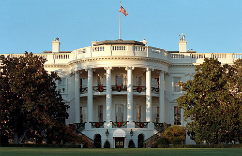 South Portico of the White House at Christmas By Susan Sterner [Public domain], via Wikimedia Commons